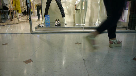 Pedestrian footsteps in the mall before the showcase window Stock Video Footage