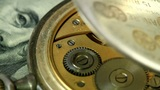 dollar and the old pendulum clock. loopable Footage