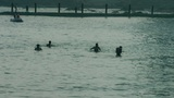 People swimming in the ocean,relying on dams,kayaking,boat Footage