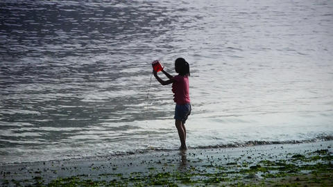 Little girl play digging sand at the beach.tide,tidal Stock Video Footage