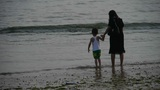 Mother with his son at the beach.tide,tidal Footage