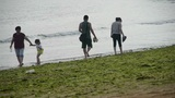 Couple,grandmother & granddaughter tourist at the beach.tide,tidal Footage