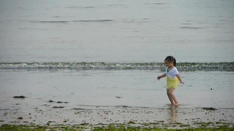 Beautiful little girl dance at beach.tide,tidal Stock Video Footage