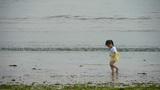 Beautiful little girl dance at beach.tide,tidal Footage
