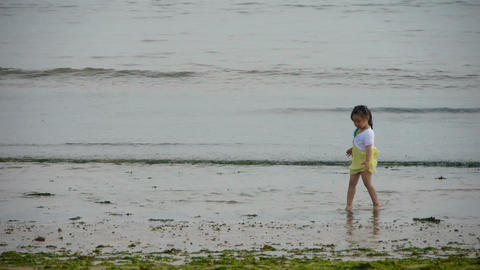 Beautiful little girl dance at beach.tide,tidal Footage