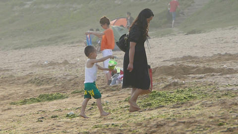 Mother with his son at the sand beach Stock Video Footage