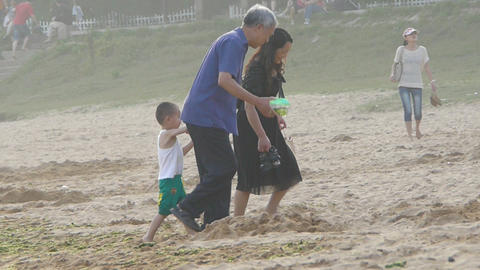 Mother with his son at the sand beach Footage