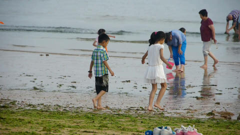 siblings child play at sand beach.tide,tidal Stock Video Footage