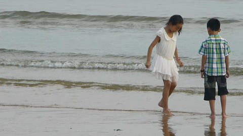 siblings child play at sand beach.tide,tidal Footage