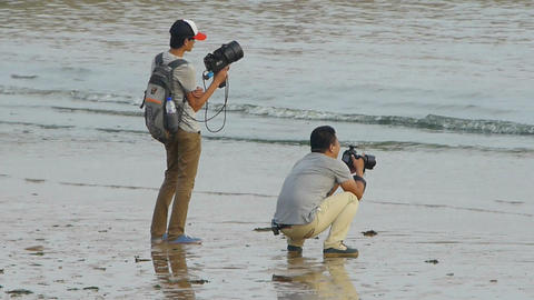 Professional photographer and his assistant at... Stock Video Footage