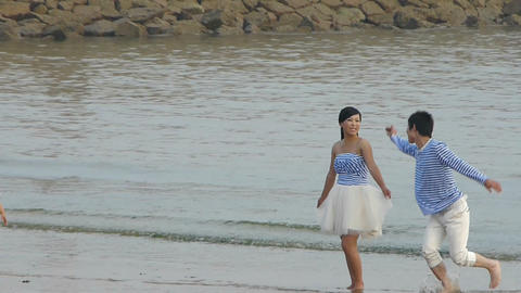 The happy couple at beach.tide,tidal Stock Video Footage