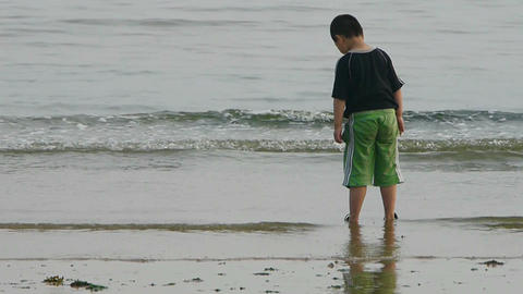 Little boy child wash hands at beach.tide,tidal Footage