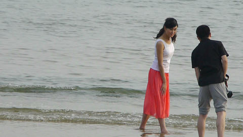 Couple at beach.Photographer taking pictures.Female model... Stock Video Footage