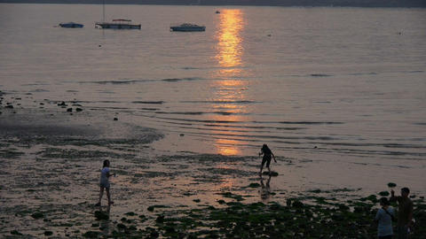 Tourist play at sand beach at dusk.tide,tidal Stock Video Footage