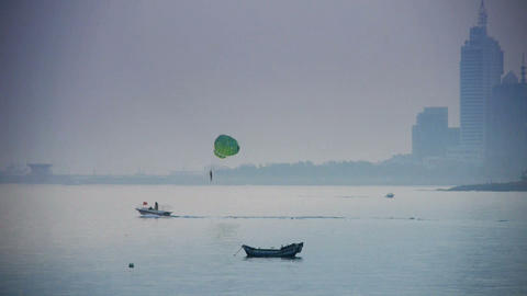 Clipper boat dragging paragliding,horizon is high-rise... Stock Video Footage