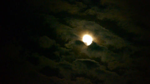 Full moon through cloudy,night flight over clouds,mystery fairyland scene Footage