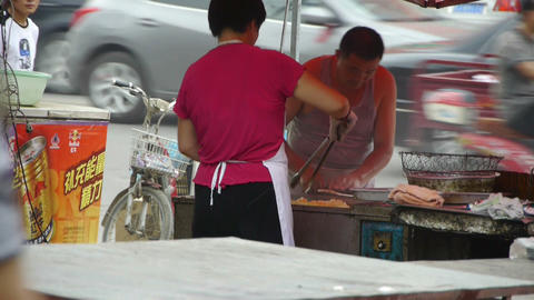 roadside snack bar cooking,China town fairs... Stock Video Footage