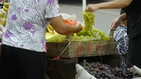 China town fairs market,selling grapes fruit Footage