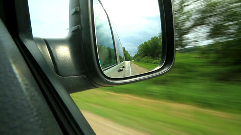 look in the mirror of a moving car Stock Video Footage
