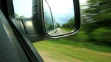 look in the mirror of a moving car Footage