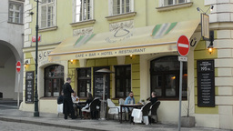 PRAGUE, CZECH REPUBLIC - MARCH 2014: Prague street - restaurant with people and  Footage