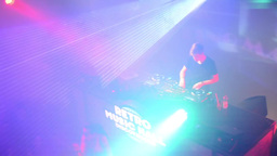 DJ plays at the disco and dancing people(disco) with stage lights Footage