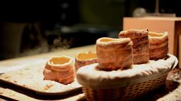 Trdelnik (chimney cake or stove cake) in shop (in night) Footage