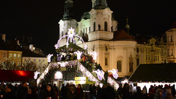 PRAGUE, CZECH REPUBLIC - DECEMBER 2013: Christmas marketplace (shops) with peopl Footage