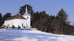 White church on the outskirts of a forest green Footage