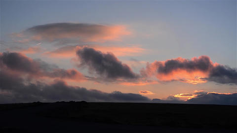 Chaotic motion of clouds at sunset 1 Footage