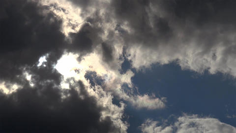 Gray clouds that leaves hardly pass sunbeams 1 Footage
