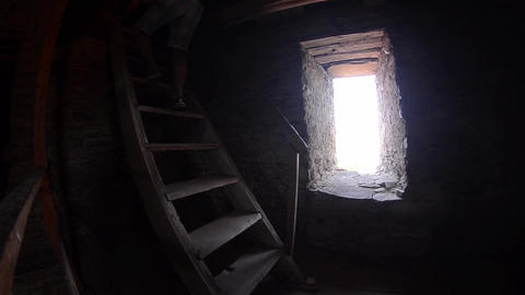 Man Down With His Back On A Wooden Staircase In An Old Tower Defense Peasant stock footage
