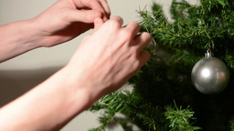 Decorating the Christmas tree with decorative balls - white background Footage