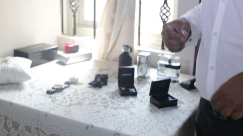 man chooses accessories to wear for wedding ceremony Footage
