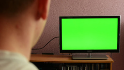 Man watches TV(television) - green screen - discontented man shakes his head and Footage