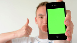 man with a phone (green screen) - man shows thumbs - man shows phone to camera Footage