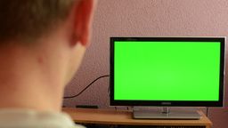 Man watches TV(television) - green screen Footage