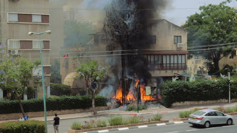 Burning cypress tree in blazing flames at the backyard of a house as a result of Footage