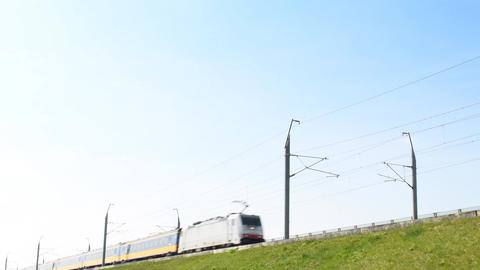 Intercity train of the Dutch Railways (NS- Nederlandse Spoorwegen) passing Footage