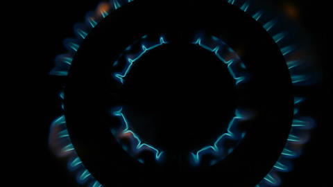 Gas burner flames - Closeup top view isolated on black background Footage