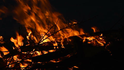 Campfire with burning log wood and twigs at night - Slow motion Footage