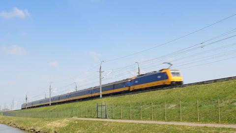 Intercity train of the Dutch Railways (NS- Nederlandse Spoorwegen) passing on a Footage