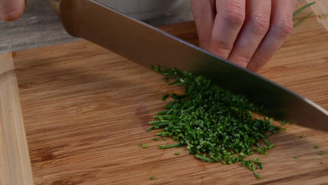 Cutting chive herbs Footage
