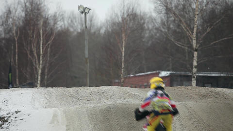 motocross jumps on motorcycle back view Footage