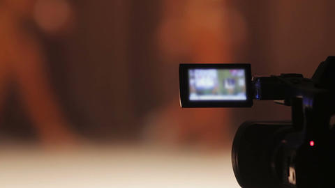 View on camera display, cameraman filming bodybuilding competition, media Footage