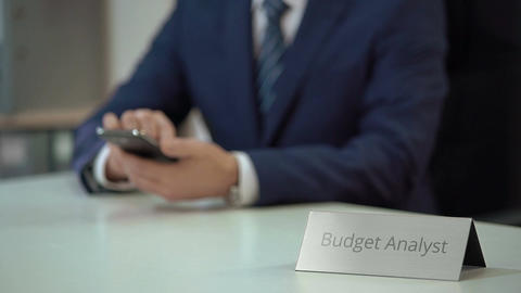 Busy budget analyst using smartphone, scrolling websites and zooming files Live Action