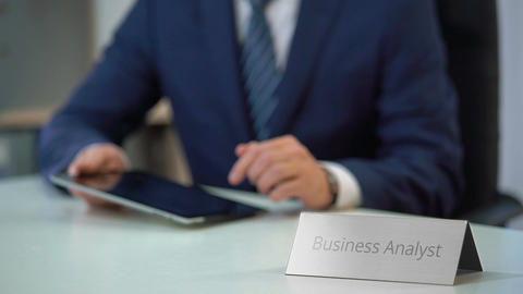 Male business analyst viewing corporate files on tablet… Stock Video Footage