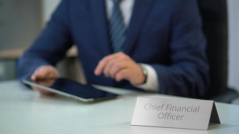Chief financial officer of corporation using tablet pc, planning company budget Live Action