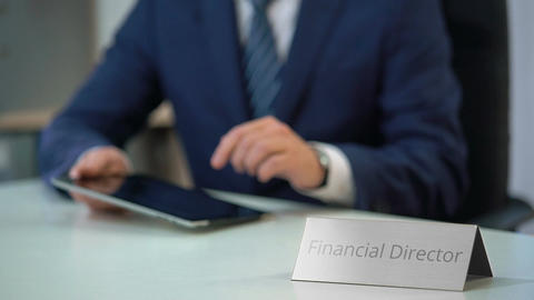 Busy financial director of corporation using tablet pc, planning company budget Live Action