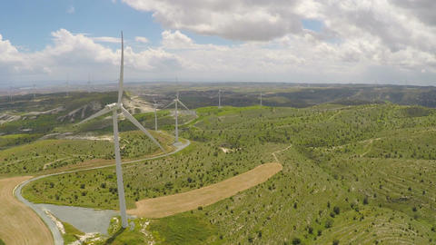 Wind turbines producing alternative green energy for modern plant or factory Footage